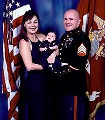 Family man: Sgt. Travis Twiggs with his wife, Kellee, and daughter.