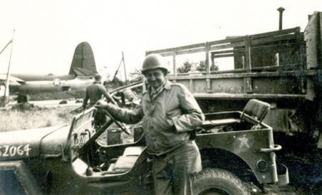 Cpl. Paul Thibodeaux stands in front of a jeep at one of the airfields built in Europe by the 843rd Engineer Aviation Battalion during World War II.