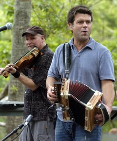David Greely onstage with his longtime musical partner Steve Riley in Covington, La.  (Times-Picayune photo by Chuck Cook)