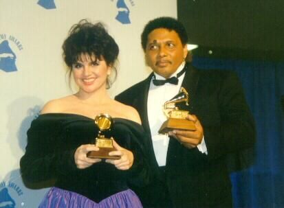 Linda Ronstadt and Aaron Neville show off some of their Grammy Awards.